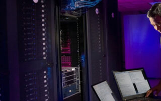Onsite IT support specialists working on the server